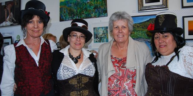 Wai Steam NZ steampunk enthusiasts Linda Tilyard (left), Katey Salmond and Gaylene van Wijk befriend Masterton mayor Lyn Patterson. PHOTO/ALISA YONG