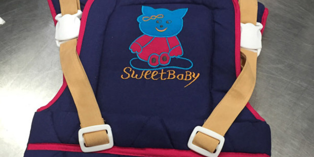 "The carriers have the words ""Sweet Baby"" and a smiling teddy bear drawn across the front. Photo / Supplied"