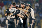 New Zealand players celebrate after defeating India by 47 runs. Photo / AP