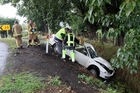 Emergency crews work to to remove this car which went into a ditch on Tukituki Rd near Haumoana. Photo / Paul Taylor