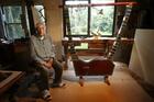 Omokoroa craftsman John Knotts with his replica of a 4500-year-old lyre. Photo / John Borren