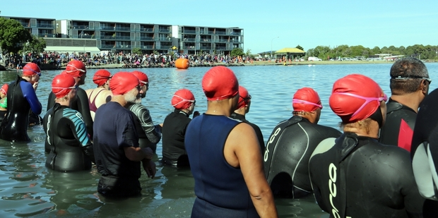 Swimmers at the moment of truth, the start of the 22nd Tremains Corporate Triathlon on Pandora Pond yesterday. Photo / Paul Taylor