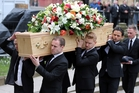Young Coro male cast members were pallbearers. Photo / Getty Images