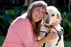 Whangarei woman Mhairi Collins with her guide dog Peace, who has opened up her world ahead of the annual Red Puppy Appeal next month. Photo / John Stone