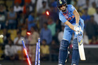 India's Ashish Nehra is bowled by Adam Milne. Photo / AP