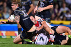 Ian Henderson of the Roosters has his lower leg broken whilst trying to tackle Ethan Lowe. Photo / Getty