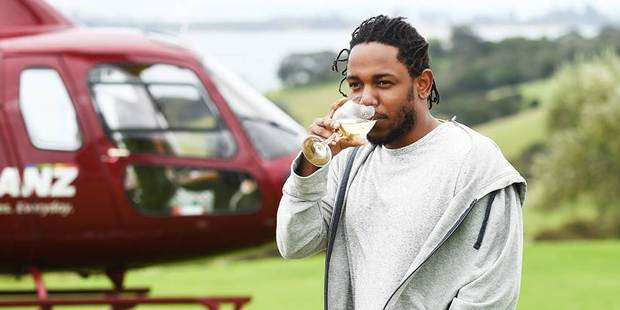 Kendrick Lamar enjoys a glass of wine during a visit to Waiheke. The rapper is the headliner at tomorrow's Auckland City Limits festival at Western Springs.