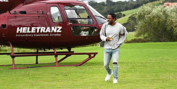 Kendrick Lamar enjoys a glass of wine during a visit to Waiheke Island.