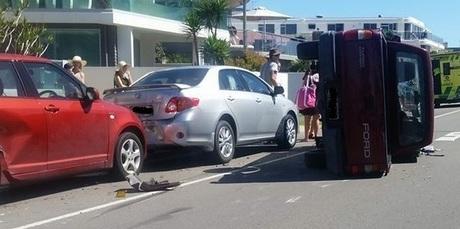A car on its side on Marine Parade in Mount Maunganui. Photo/Casey Ireland