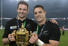 Richie McCaw and Dan Carter celebrate with the Rugby World Cup trophy. Photo / Brett Phibbs