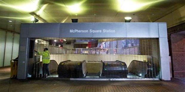 Metro employee shuts down escalators to the McPherson Square Station in Washington, Wednesday, March 16, 2016. Photo / AP