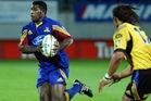 Seru Rabeni goes up against Tana Umaga when playing for the Highlanders. Photo / Getty