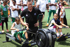 New Zealand Olympic Team Chef de Mission Rob Waddell presented two new rowing machines to the Mangueira community in Rio.
