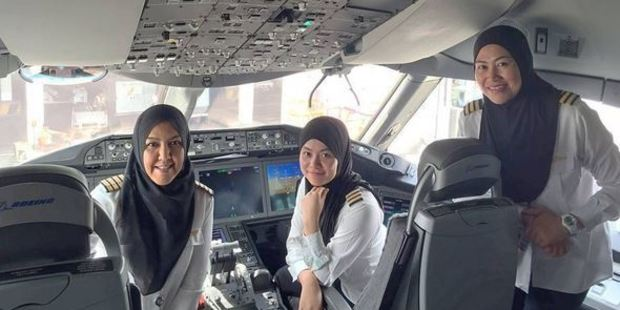 Royal Brunei Air's first all-female flight crew sitting in the cabin of a Boeing 787 Dreamliner. Photo / Royal Brunei Air Instagram