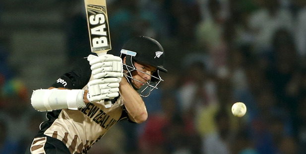 Mitchell Santner plays a shot against India during the ICC World Twenty20 match this morning. Photo / AP
