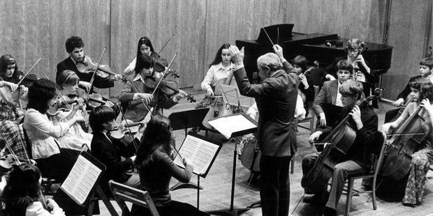 Roman Totenberg conducts a student orchestra. Photo / Totenberg family via NPR