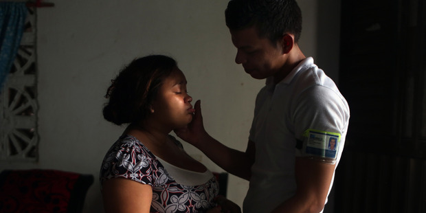 Ana Jhoana Acevedo's fiance Damian Ferreira visits her at home after he is off from work in Cartagena, Colombia. Photo for The Washington Post by Dania Maxwell