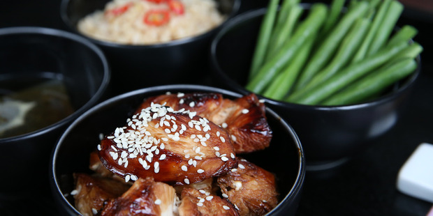 Teriyaki chicken with beans and rice. Photo / Getty Images