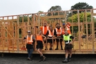 Students on EIT's 10-month Level 3 carpentry course in Dannevirke. Seven students are currently undertaking the practical aspect of the course, building a three-bedroom, two-bathroom house at Tumu Timbers' yard which will be auctioned. Pictured, students with EIT tutor Campbell