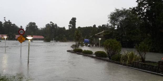Flooding in Franz Josef. Photo / Nicolaas Bester