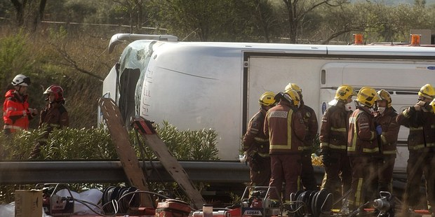 Emergency services at the scene of the crash which happened in Catalonia, Spain. Photo / AP