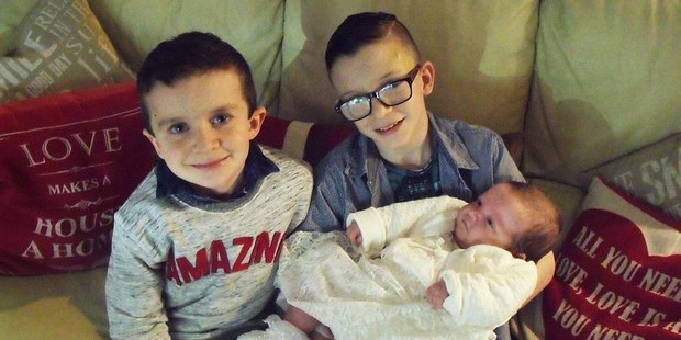 Evan and Mark with their baby sister Rionaghac-Ann.