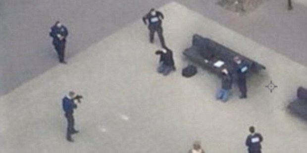 Security forces in Brussels arrest two in the wake of the terror attacks in the city.