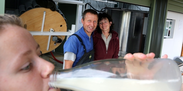 RAW DEAL: Milk supplier Edo Mooij - pictured with wife Anita and daughter Emily - will keep his business on No 3 Line going.
