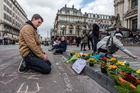 Messages and flower tributes have appeared around Brussels since the attacks. Photo / AP