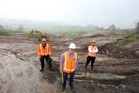 Engineers John Balcombe and Rob Mackie of Downer, and the NZTA's Nat Larmer oversee the massive earthworks under way at Akerama. Photo / Michael Cunningham