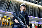 A German police officer guards a terminal of the airport in Frankfurt, Germany after two explosions hit the Belgian capital Brussels. AP photo / Michael Probst