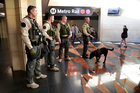 Members of Los Angeles County Sheriff's Department patrol at Union Station in Los Angeles, after the terror attacks in Brussels. Photo / AP