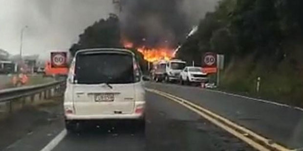 A fire is burning alongside State Highway 2 in Lower Hutt. Photo / Facebook