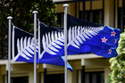 The Kyle Lockwood designed-flags flutter outside a hotel in Wellington. Photo / Getty Images