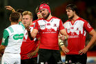 Warren Whiteley of the Lions argues with referee Chris Pollock. Photo / Getty