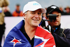 John Key wears the New Zealand flag given to him by former Australian cricketer Ricky Ponting during day four of the 2016 New Zealand Open. Photo / Getty Images