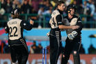 Luke Ronchi celebrates with spinner Mitchell Santner and skipper Kane Williamson. Photo / Getty