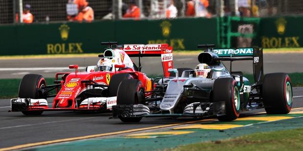 Lewis Hamilton gets overtaken by Sebastian Vettel during the Australian Grand Prix. Photo / Getty Images