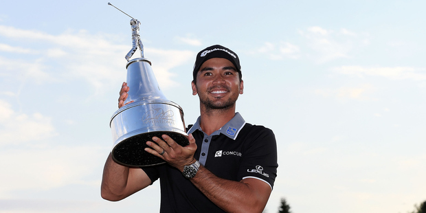Jason Day poses with the trophy at the Arnold Palmer Invitational. Photo / Getty Images