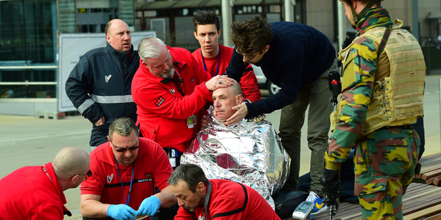 A victim of the Brussels metro attack receives first aid. Photo / Getty Images
