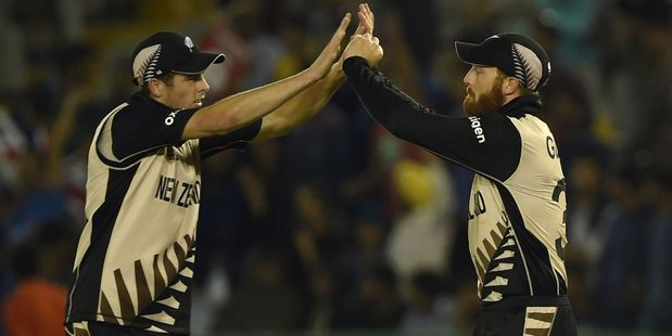 Mitchell Santner celebrates with Martin Guptill during the Black Caps' win over Pakistan. Photo / Getty