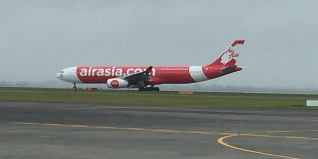 AirAsia X A330-300 lands at Auckland International Airport.