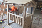 Max Southworth works on his winning playhouse. Photo/Supplied