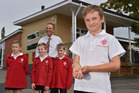Wasp attack victim Daniel Wheeler (front, 9), of Fairfield School, shows the results of the stings yesterday, with fellow campers behind him. Photo / Otago Daily Times / Gregor Richardson
