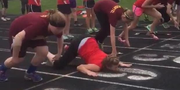 The video shows Kroge, 14, brutally face-planting twice in the opening 10m of a running race. Photo / Twitter.