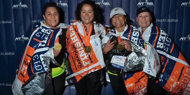 Niva with Achilles Foundation athlete Maryanne hooson and guide Rebecca Drage after the New York Marathon, 2013.