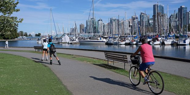 Cycling through Stanley Park is a popular activity. Photo / 123RF