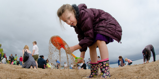 Loading Rose Parkman, 6, working hard with her spade at The Hits Beach Dig. Photo / Stephen Parker