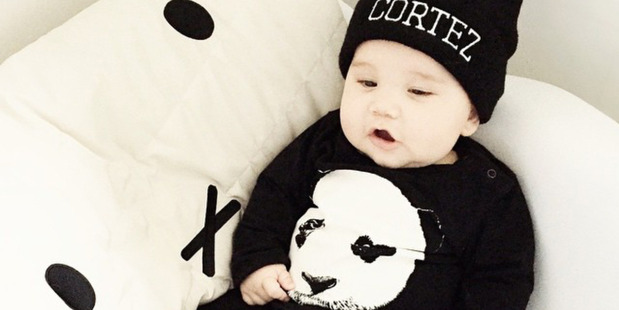 Cortez Paewai, pictured at 6 months on Instagram, is an unsuspecting model for a copy of the panda onesie he wears. Photo / fromlondontobrooklyn