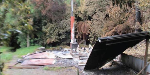 The gutted hut in Te Urewera ranges which police say was deliberately set alight. PHOTO/SUPPLIED
